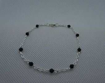Silver bracelet with black beads