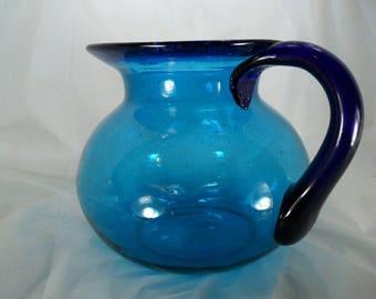 Hand blown glass pitcher