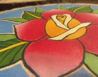 Traditional rose painting on wooden slice