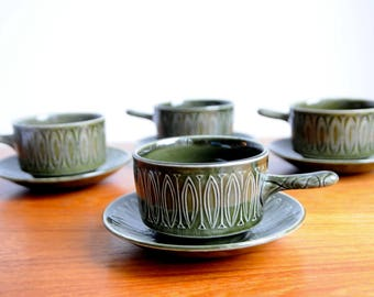 Set of four Tams Pottery soup bowls with saucers, Sahara pattern, olive green.