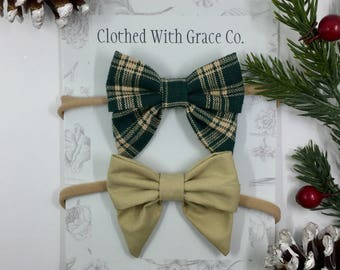 Set of 2 Holiday Sailor bows; Available either on a nude nylon headband or alligator clips