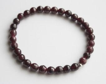 Garnet genuine gemstone elasticated bracelet.