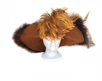 Vintage wide-brimmed brown/rust colored hat with large feather plume, feather accents, and feather-edged brim