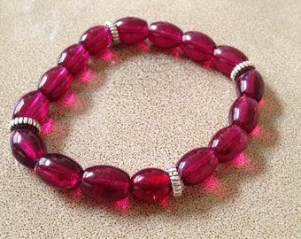 Dark pink glass beaded stretchy bracelet