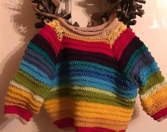 Hand knitted baby rainbow sweater.