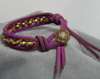 Purple fushia suede leather wrap bracelet with purple and gold glass beads. Gold toned moons and stars button