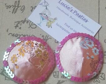 Pink material round nipple pastie