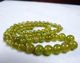 Green grossular garnet smooth round beads/5-8mm/7.5 inch strand