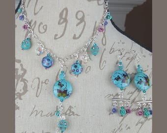 Skully Butterfly and Flower Garden necklace and earrings set.