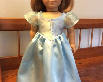 A lovely ice blue ball gown with headband made for an 18 inch doll such as American girl and the like size