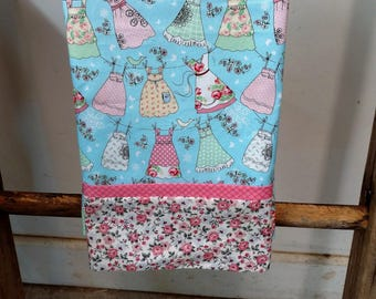 Pillowcase for the little girl in your life.  It has little dresses hanging on a clothesline.  Background is blue accented by pink flowers