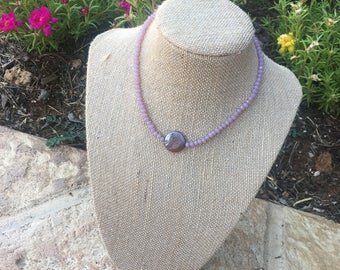 light purple choker with a purple pearl in center with clasp