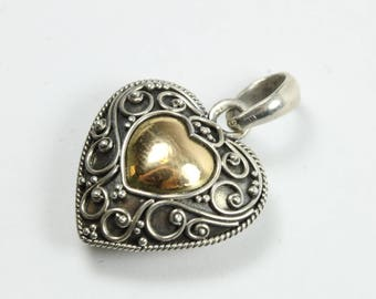 A Vintage Style Sterling Silver Filigree Heart Shaped Pendant