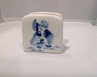 Ceramic napkin holder with Dutch motif of windmill and boy and girl kissing