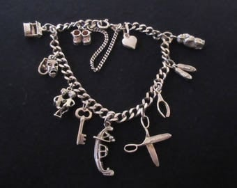 Vintage Italian 925 Sterling Silver Charm Bracelet with 11 Unique Charms.