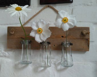Recycled bottles, jubilee clips and pallet wood wall hung vases