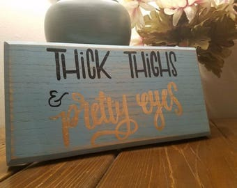 Thick thighs & pretty eyes wall decor sign