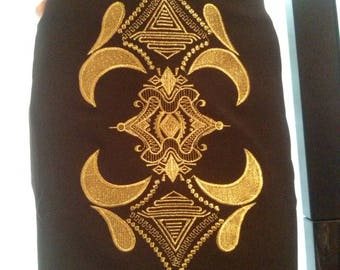 Short black skirt embroidered with golden thread