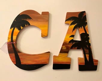 CA bronze and gold sunset letters