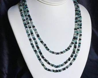 Multi strand black and turquoise necklace