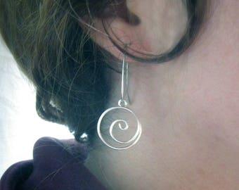 Spiral shape silver wire earrings.