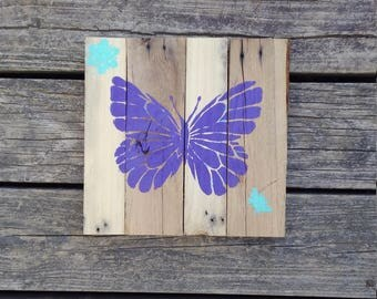 Small butterfly sign with bee and flower