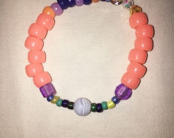 peachy colorful beaded bracelet with stone bead.