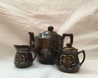 Brown  tea pot with sugar and creamer