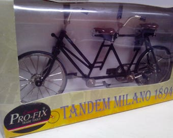 Diecst of Early Tandem Bike.