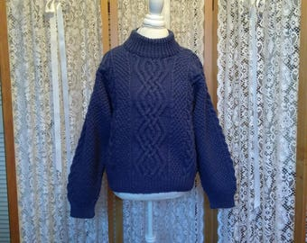 Gently used, wool blend fisherman's crew sweater in cadet blue. Size M.