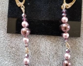 2.5 inch pierced dangle purple and lavender pearl and purple crystal earrings.