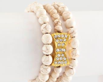 Cream, gold bow, 3 stack Glam bracelet
