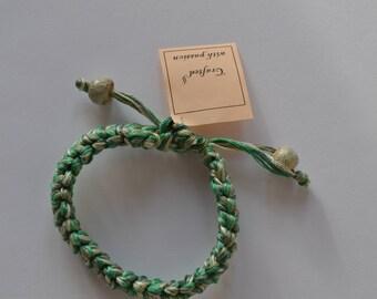 green crocheted bracelet