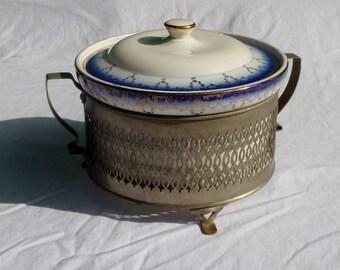 antique ceramic casserole dish wiht lid and stand