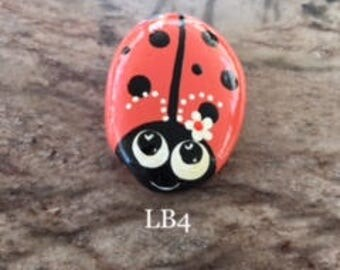 Coral Ladybug with a Daisy, Hand painted Rock -  Lb4