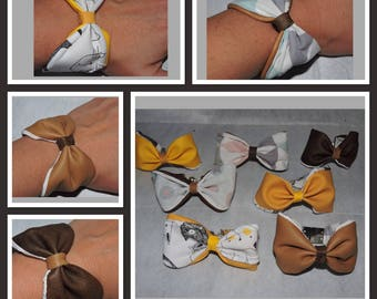 Bow bracelet reversible leather and fabric.