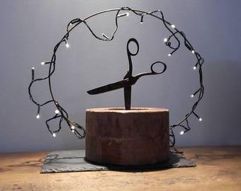 Sculpture scissors on wooden base. guinguette dancers