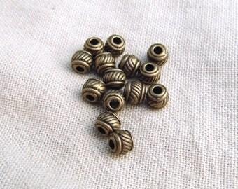 10 pearls ridged barrel 6 x 5mm bronze A22032