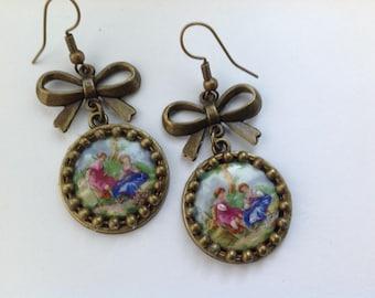 Pair of earrings in metal and porcelain