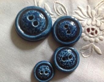 Set of four round ceramic buttons