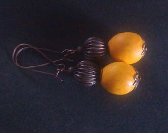 Earrings made of wood ash and copper