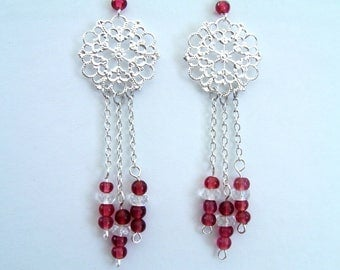 Hanging beads and silver charm earrings