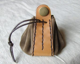 Coin purse is taupe camel leather hand stitched