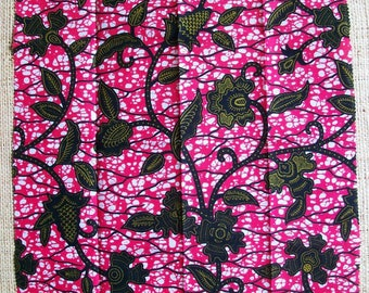 African Wax fabric in shades of pink, green olive and black