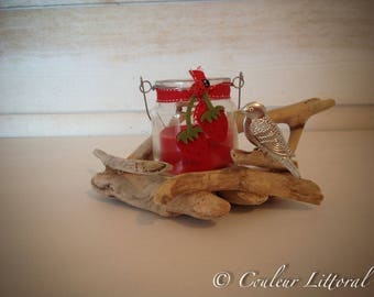candle in glass on Driftwood