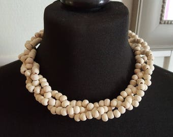 Choker necklace woven with natural wood beads