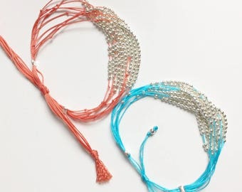 Bracelet multi strand turquoise or coral beads