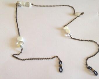 Bronze and white glasses cord