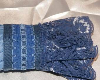 BLUE CUFF BRACELET HAS RUFFLES AND LACE