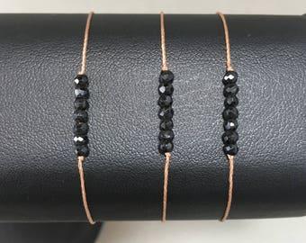 Adjustable bracelet with 7 small black spinels